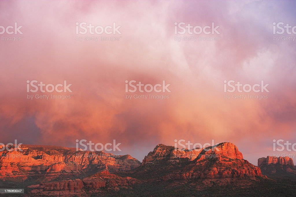 Sunset Rain Storm Red Rock Mountains stock photo