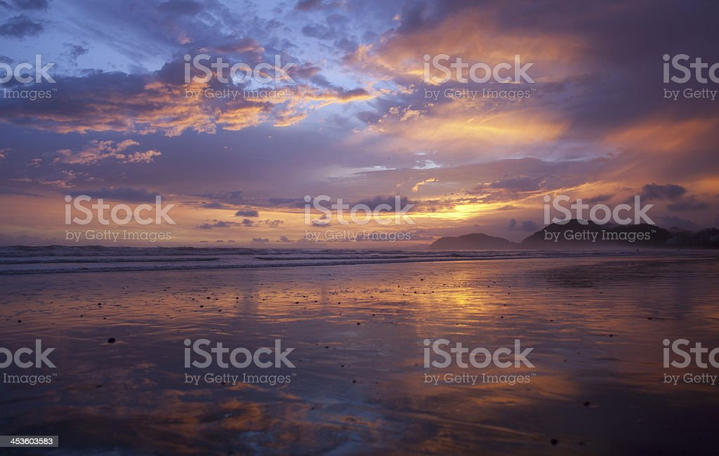 Sunset reflected on the beach in Costa Rica. royalty-free stock photo