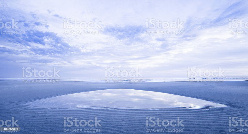 Sunset reflecting in a tidal pool stock photo
