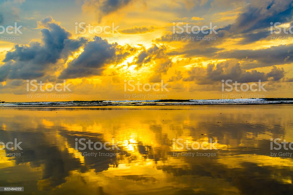 Sunset reflection at the beach stock photo