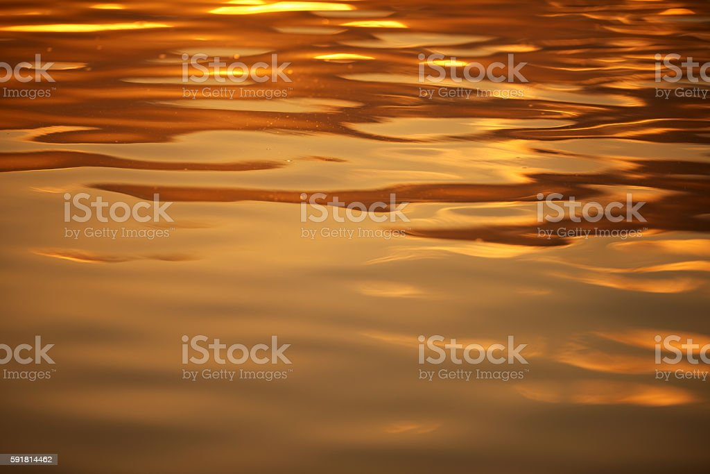 sunset reflection in the water stock photo