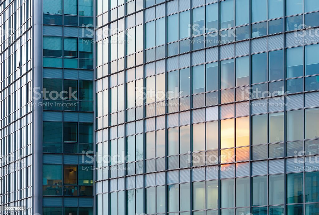 Sunset reflections in skyscraper wall stock photo