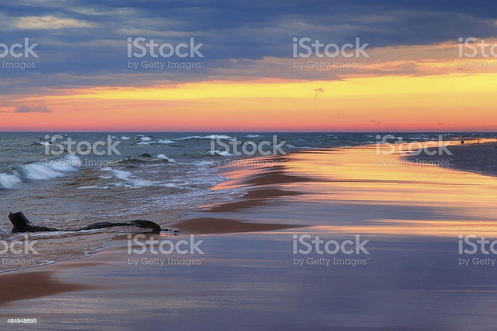 Sunset Reflections on Beach stock photo