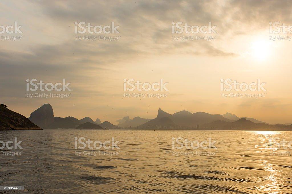 Sunset Rio de Janeiro mountains from the Guanabara Bay stock photo