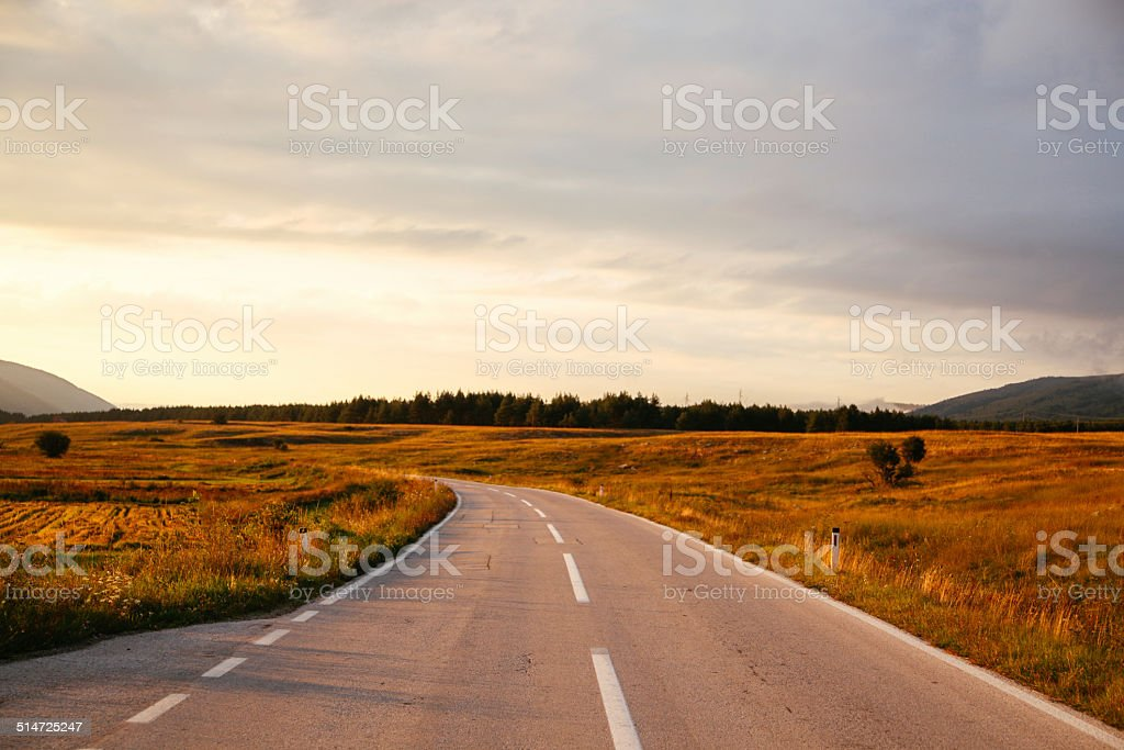 sunset road stock photo