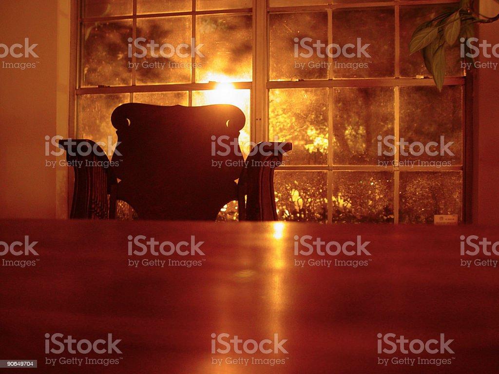 sunset rocking chair stock photo