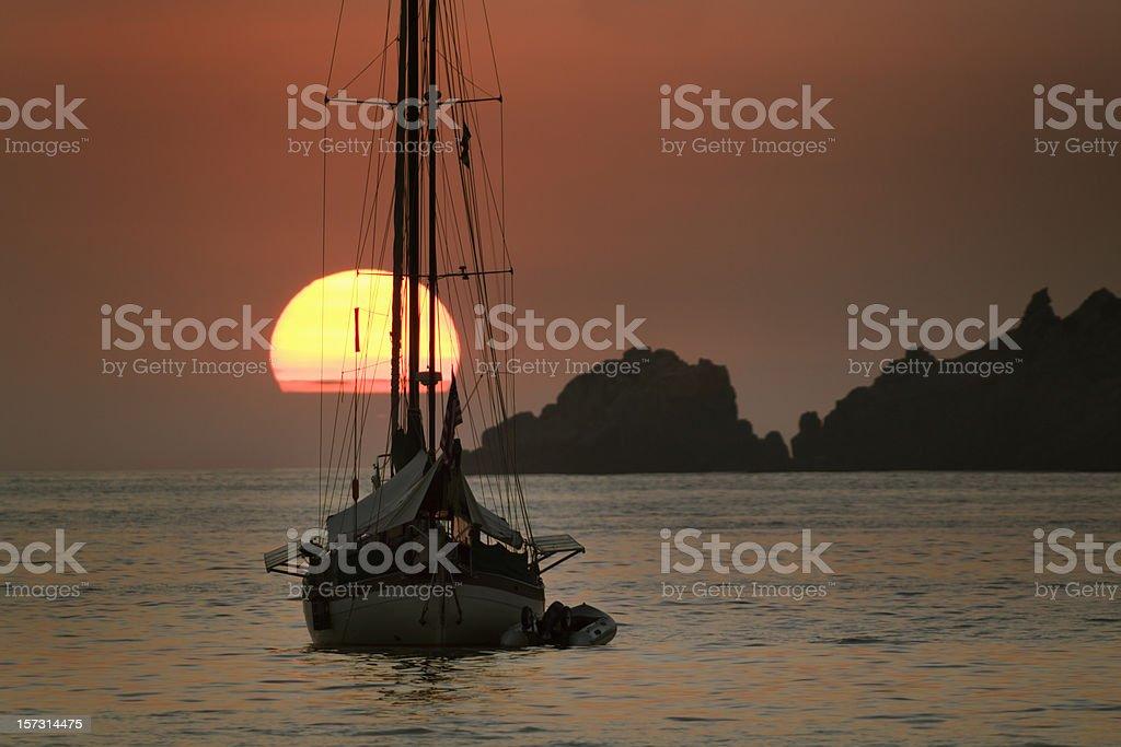 Sunset & Sailboat stock photo