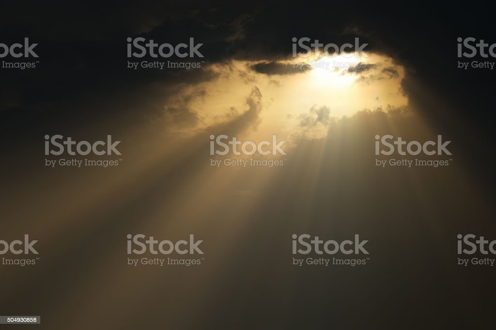 Sunset scene with light rays stock photo