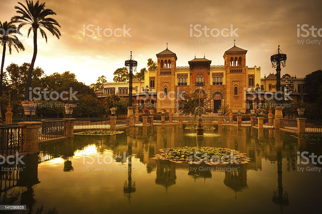 Sunset scenic view of Mudejar Pavilion and pound in Sevilla royalty-free stock photo