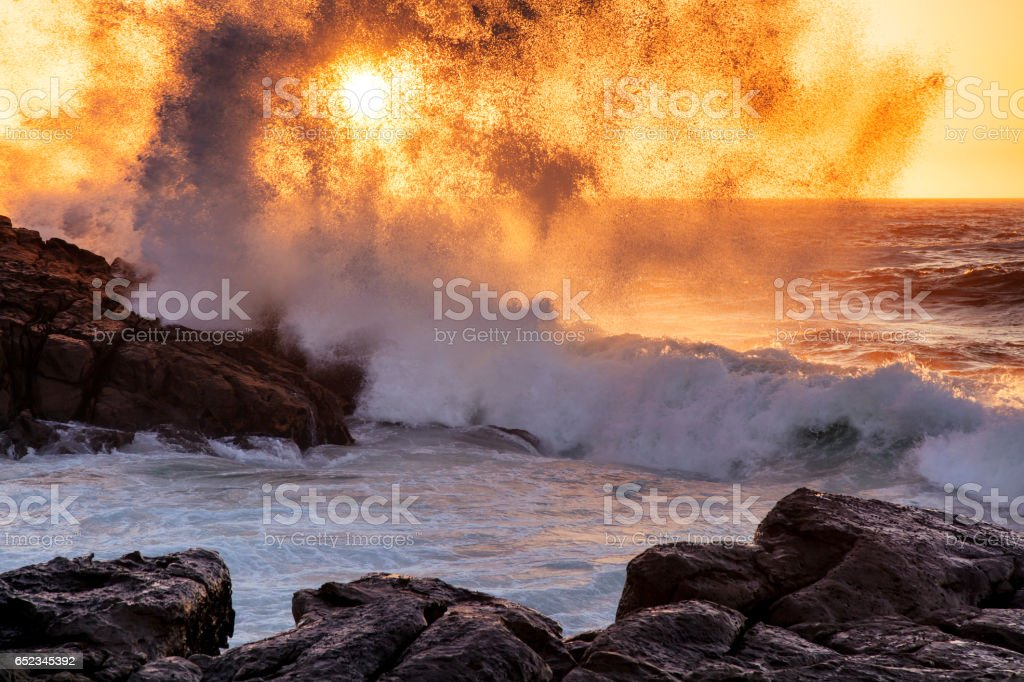 Sunset seen through splashing waves, Lamberts Bay, South Africa stock photo