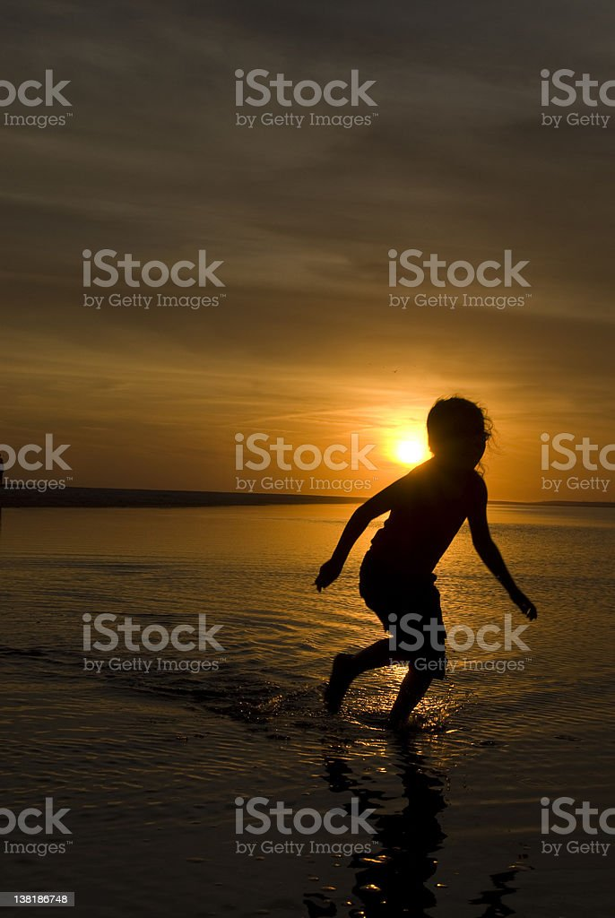 Sunset Silhouette Girl Running royalty-free stock photo
