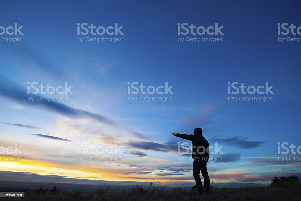 sunset silhouette man leadership royalty-free stock photo