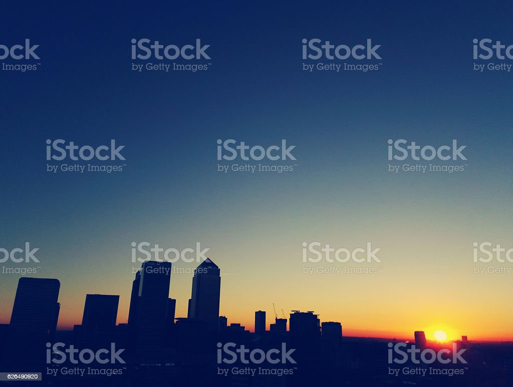 Sunset silhouette over Canary Wharf stock photo