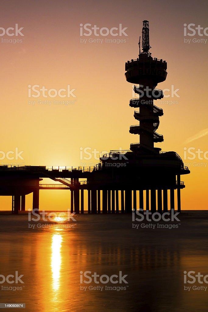 Sunset silhouette pier stock photo