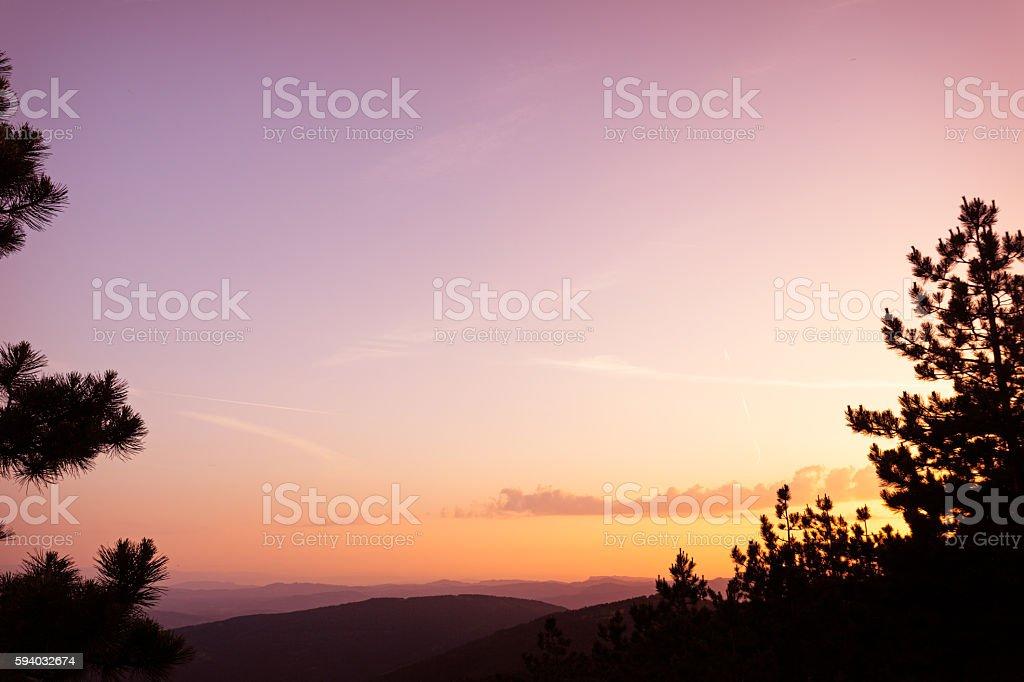 Sunset sky and mountain range stock photo