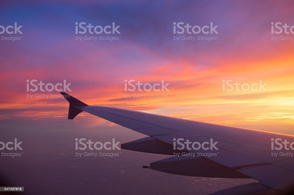 Sunset sky from the airplane window stock photo