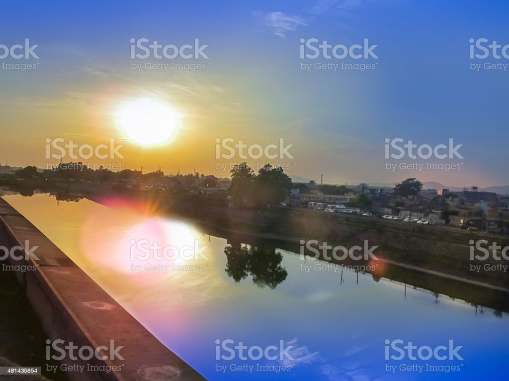 Sunset sky of multiple colors and its reflection on water stock photo
