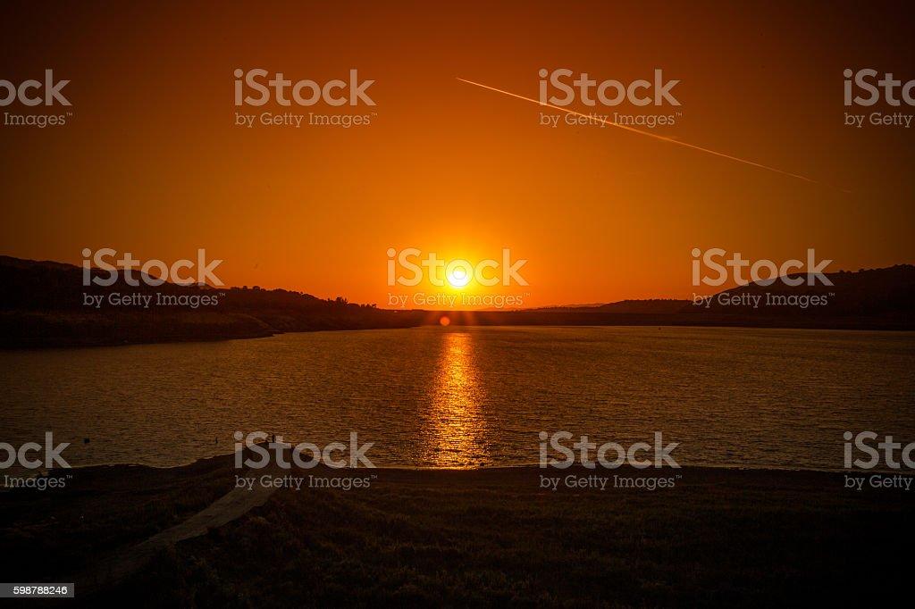 Sunset sky over a lake stock photo