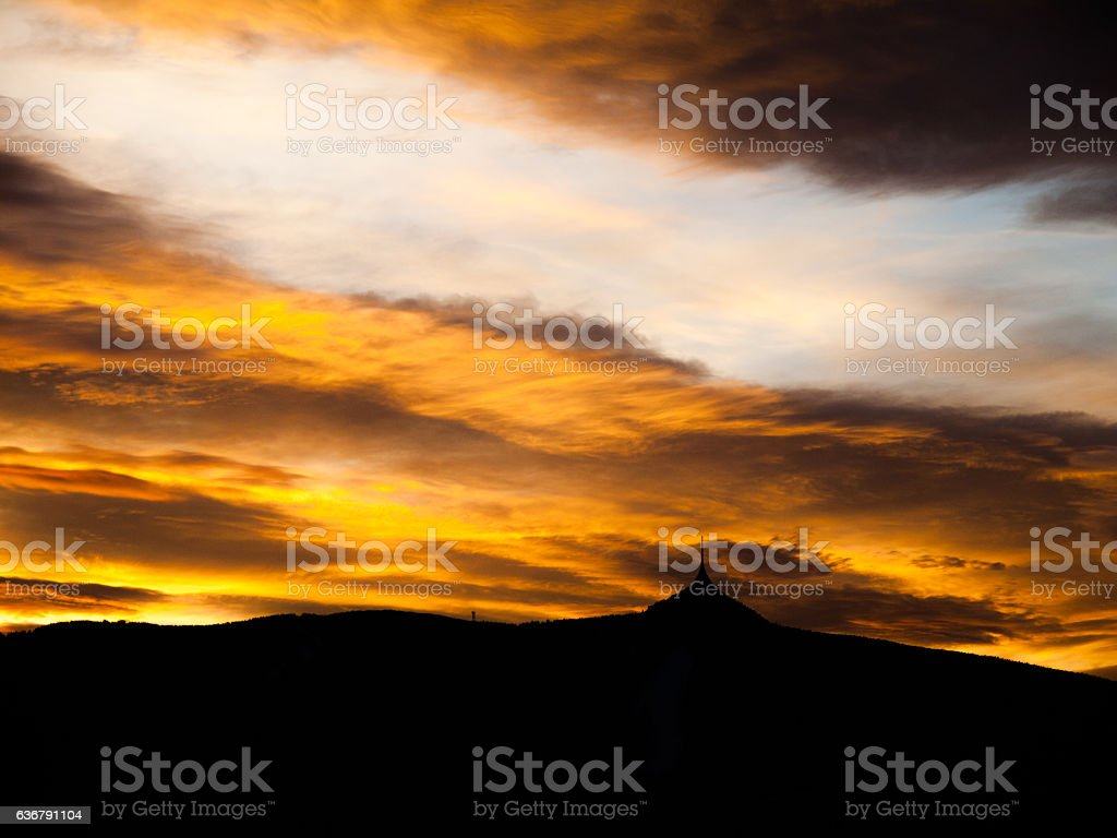 Sunset sky panorama with silhouette of Jested Mountain Ridge, Liberec stock photo