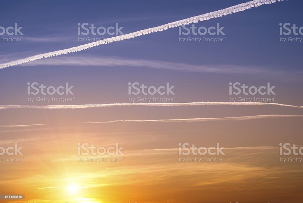 Sunset sky with contrails stock photo