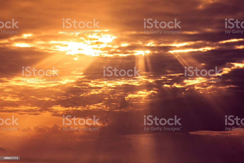 sunset sky with light rays stock photo