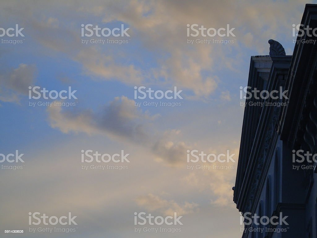 Sunset sky with ornate Victorian building stock photo