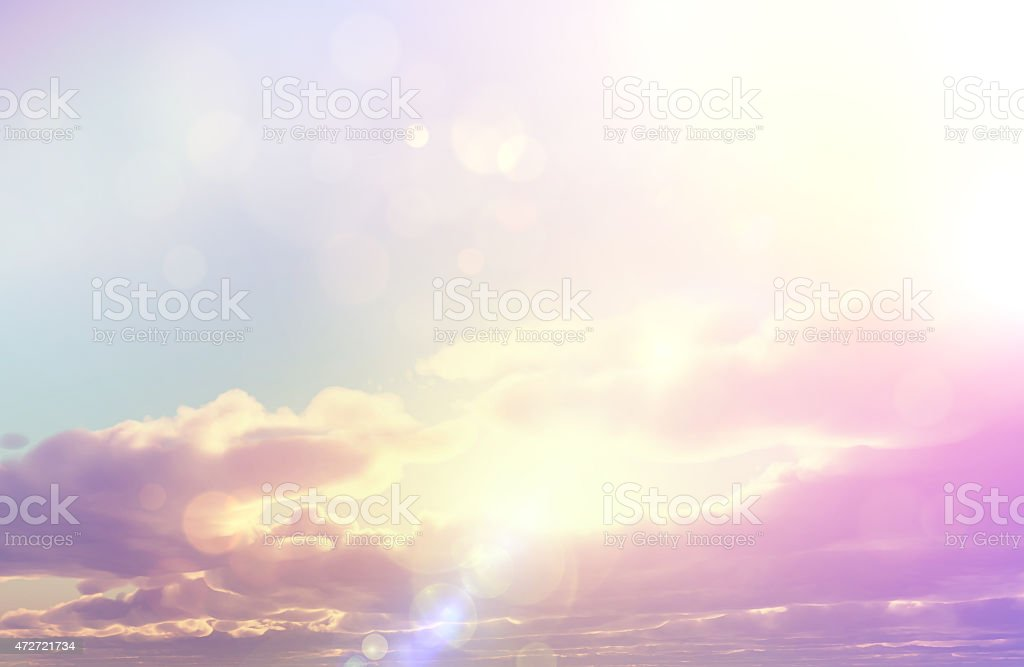 Sunset sky with retro effect and bokeh lights stock photo