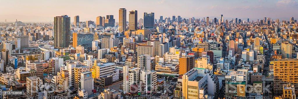 Sunset skyscrapers crowded cityscape futuristic skyline highways panorama Osaka Japan stock photo