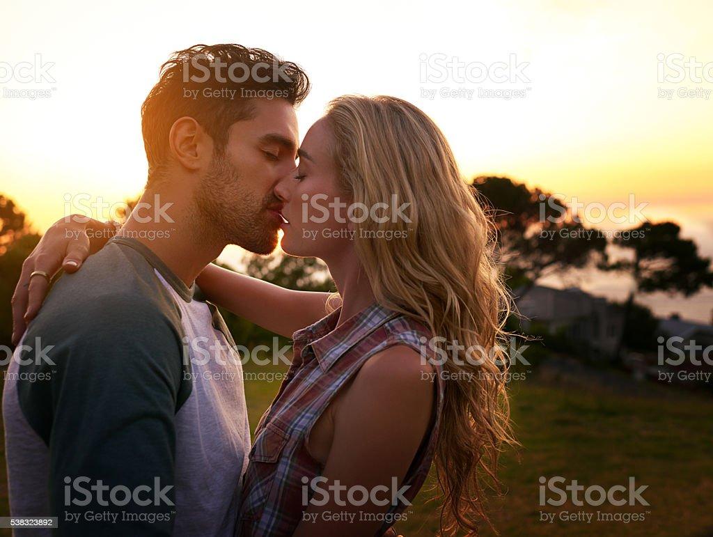 Sunset smooches stock photo