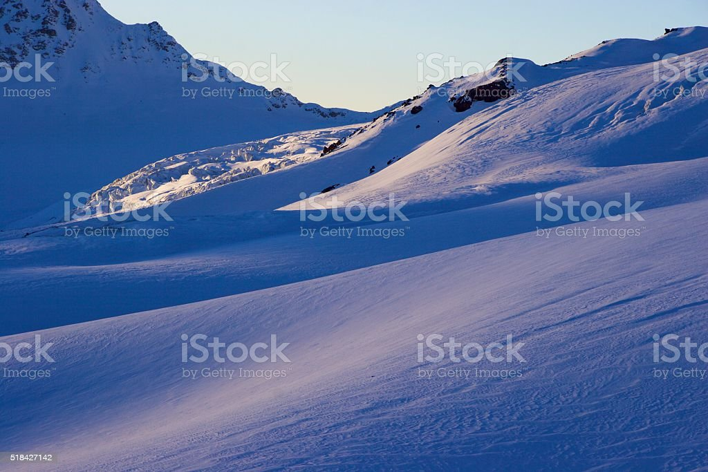 Sunset snow slope stock photo