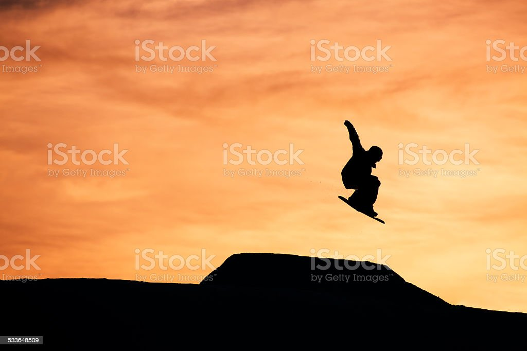 Sunset Snowboarder stock photo
