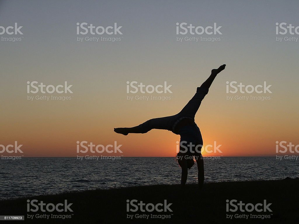 sunset split handstand stock photo