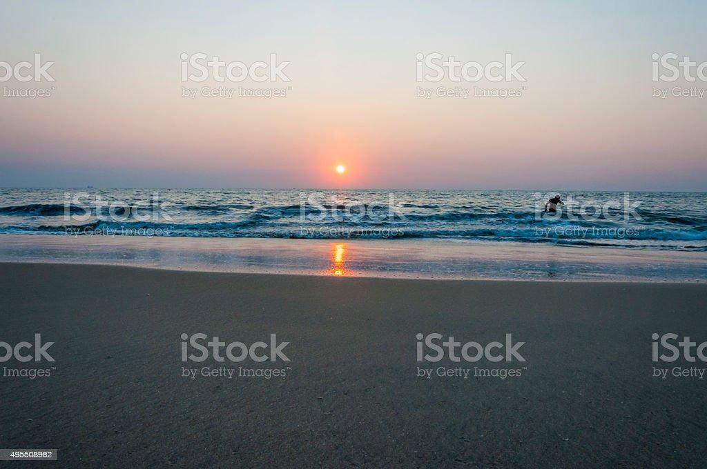 Sunset sun above the Arabian sea beach in Kochi, India. stock photo