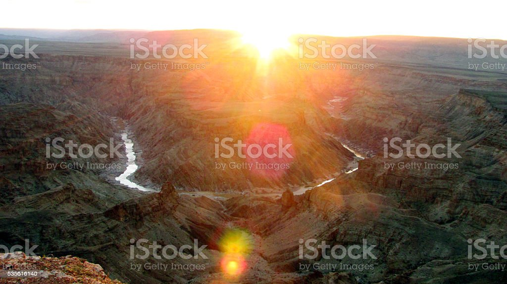 Sunset sun Africa Fish River Canyon arid desert stock photo