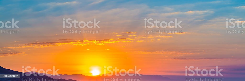 Sunset Sunrise Over Dark Mountain Silhouette stock photo