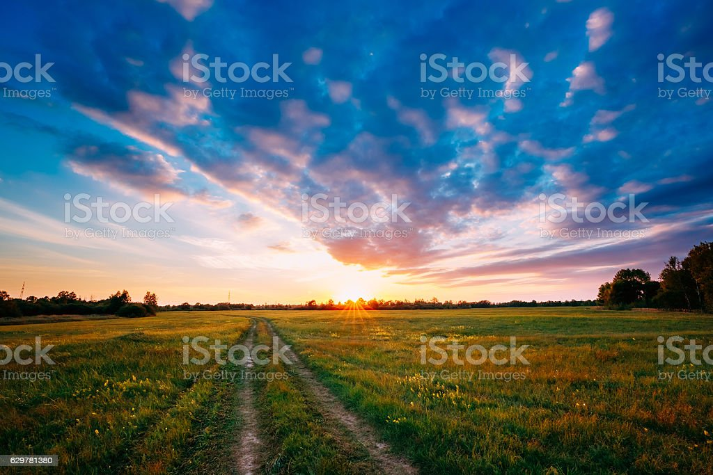 Sunset, Sunrise Over Rural Field Meadow. Bright Dramatic Sky stock photo
