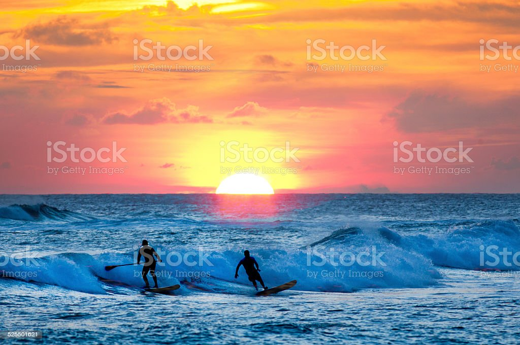 Sunset Surfer and Paddle Board on Pacific Waves, Kauai, Hawaii stock photo
