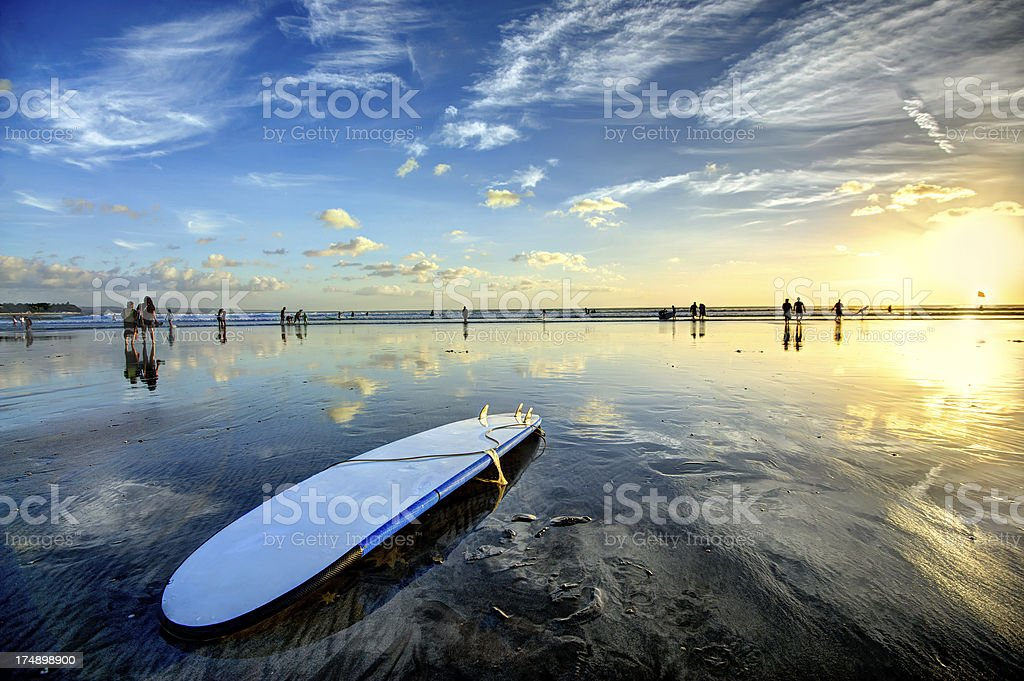Sunset Surfing stock photo