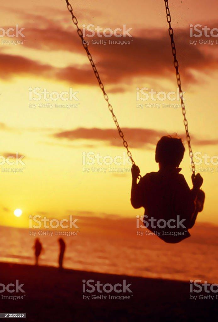 sunset swinging stock photo