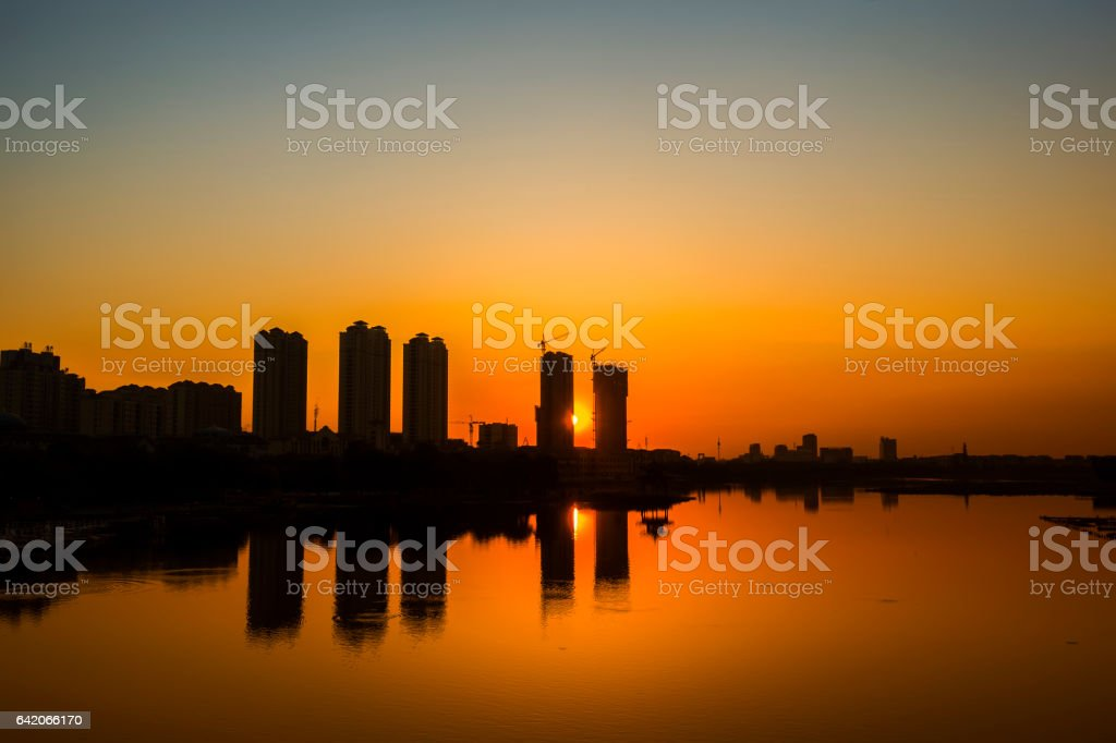Sunset, the silhouette of the city stock photo