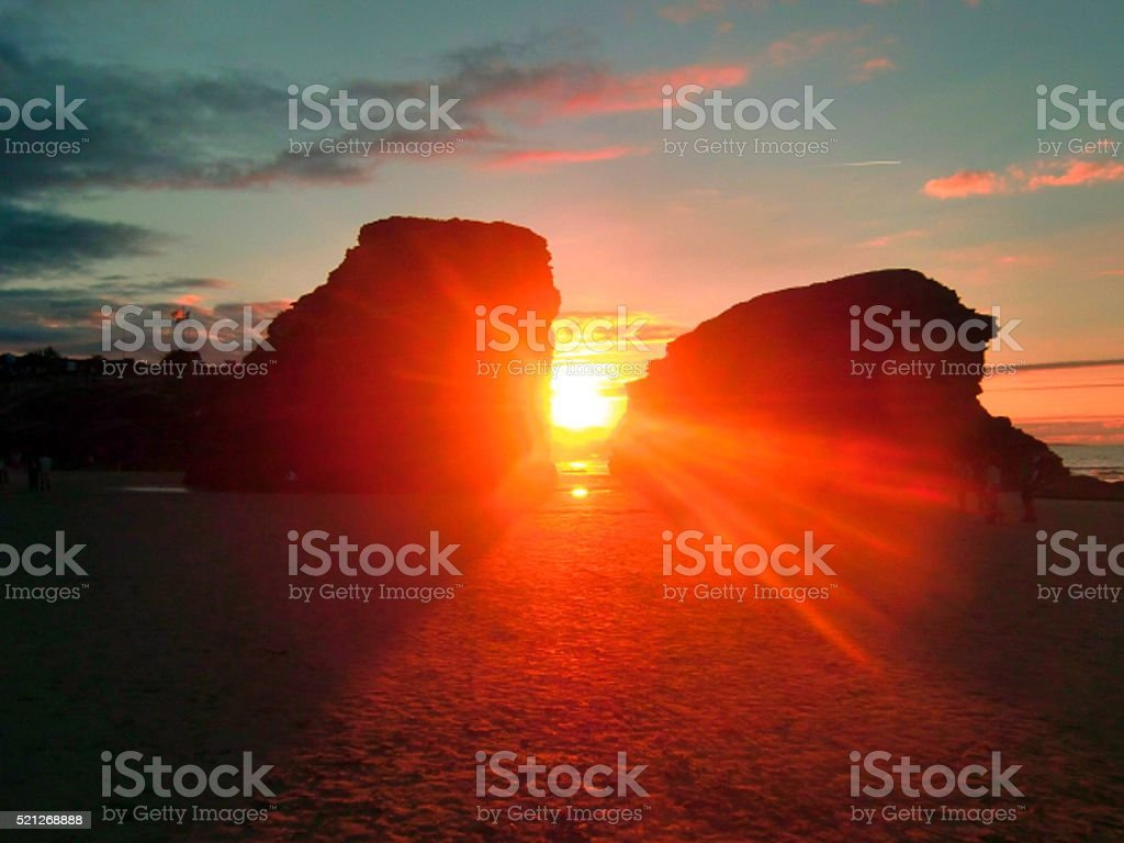 Sunset through a hole in the rock,  Galicia, Spain stock photo