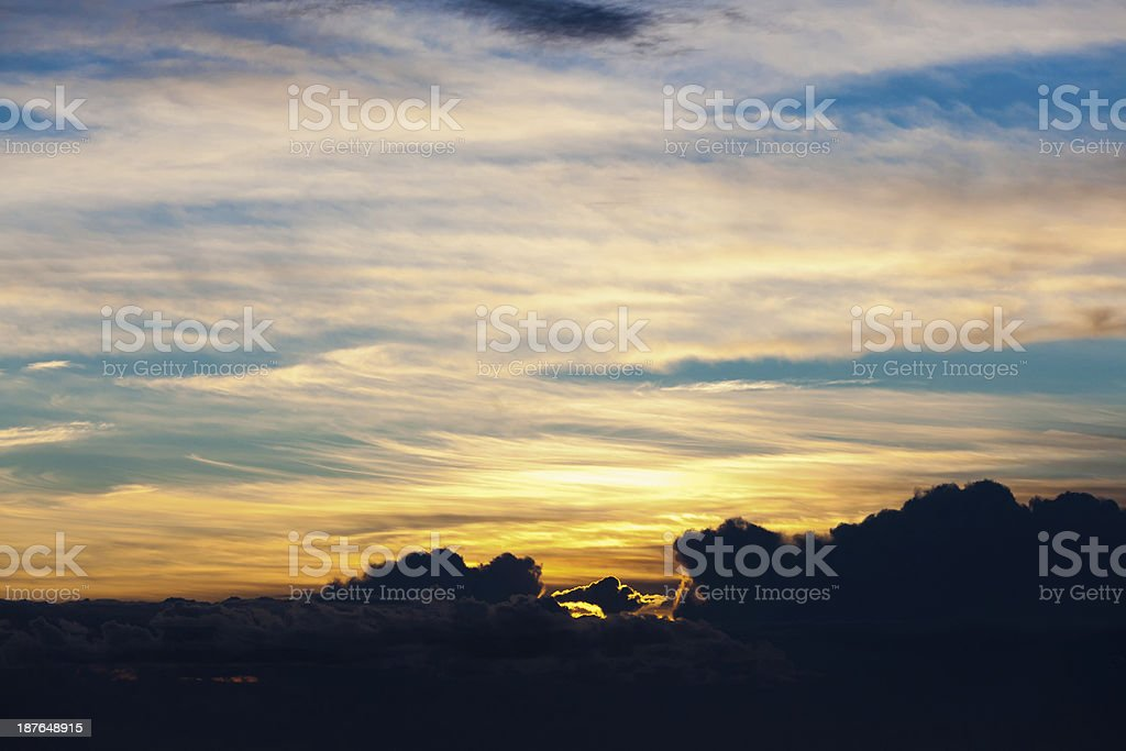 Sunset through clouds royalty-free stock photo