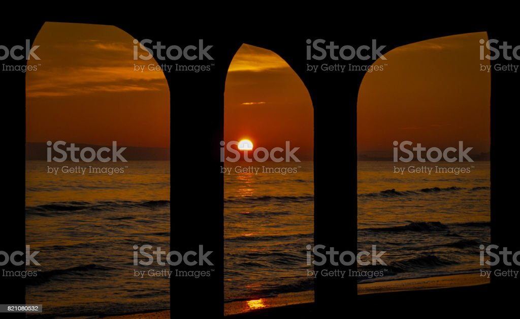Sunset through the arches stock photo