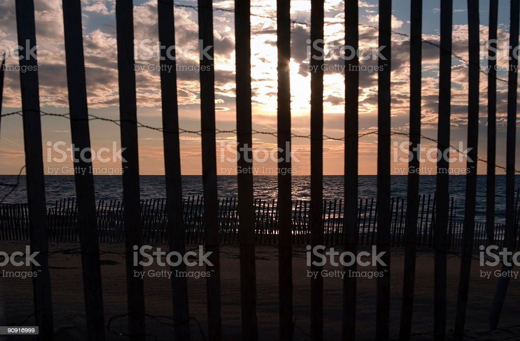 Sunset through the Fence royalty-free stock photo