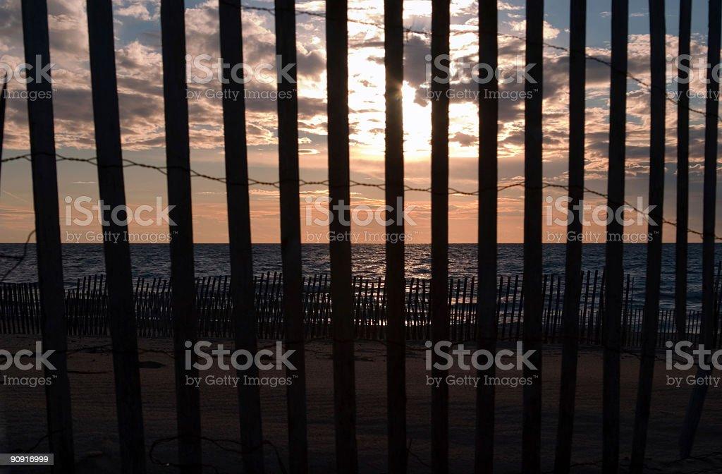 Sunset through the Fence stock photo
