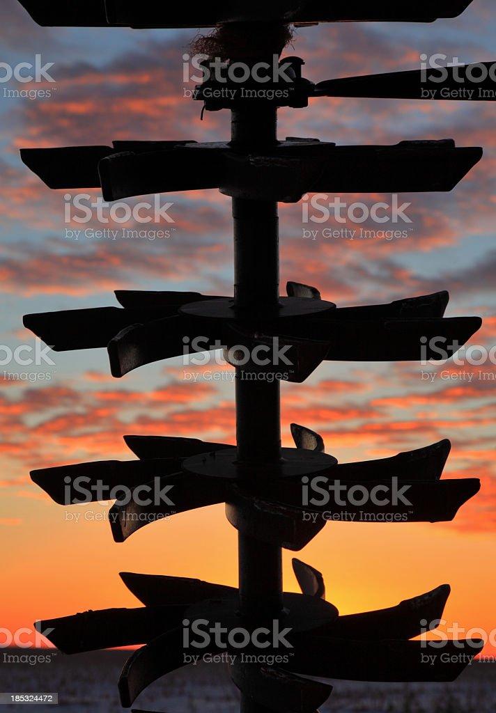 Sunset through the plow stock photo