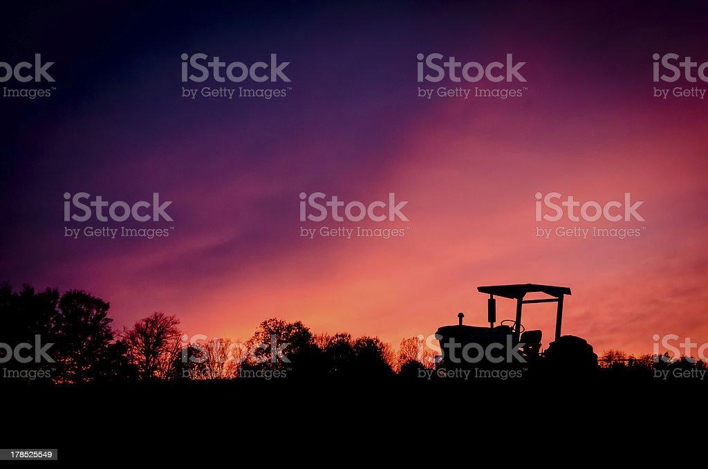 Sunset Tractor stock photo