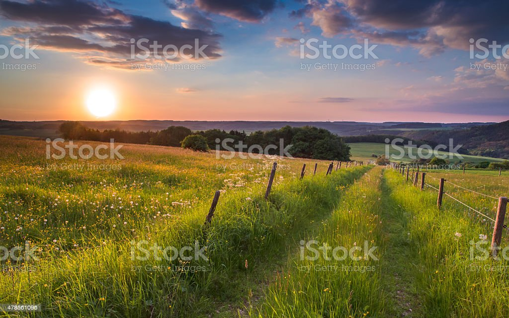 sunset trail germany hill stock photo
