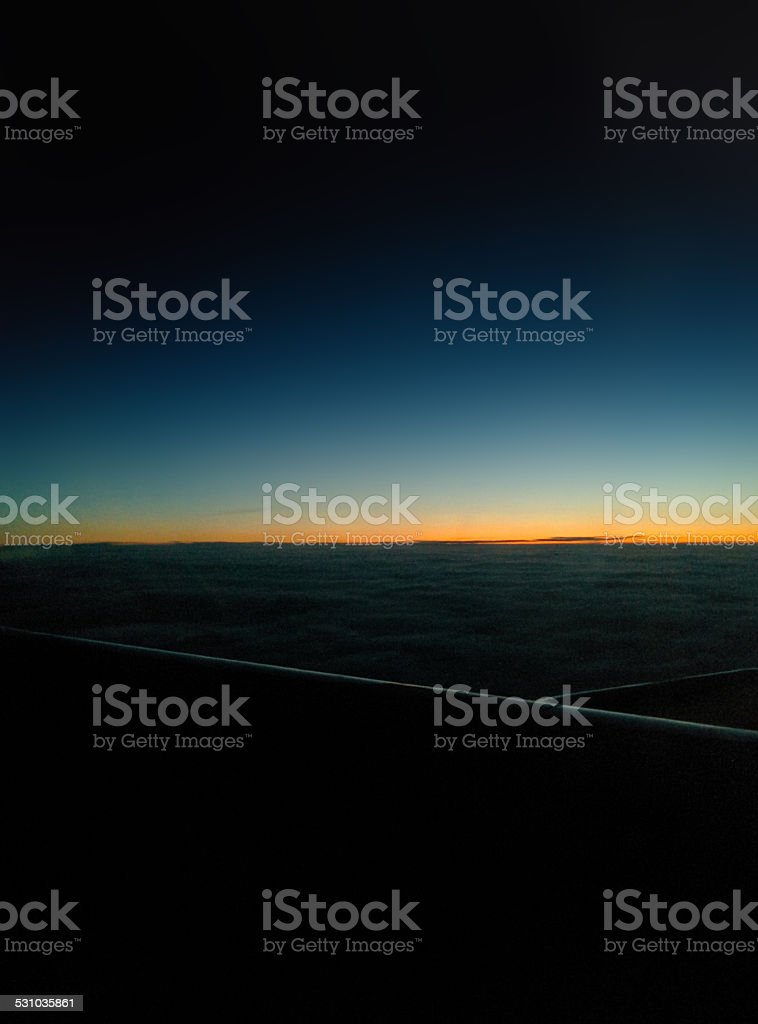 Sunset under the clouds during the airflight royalty-free stock photo
