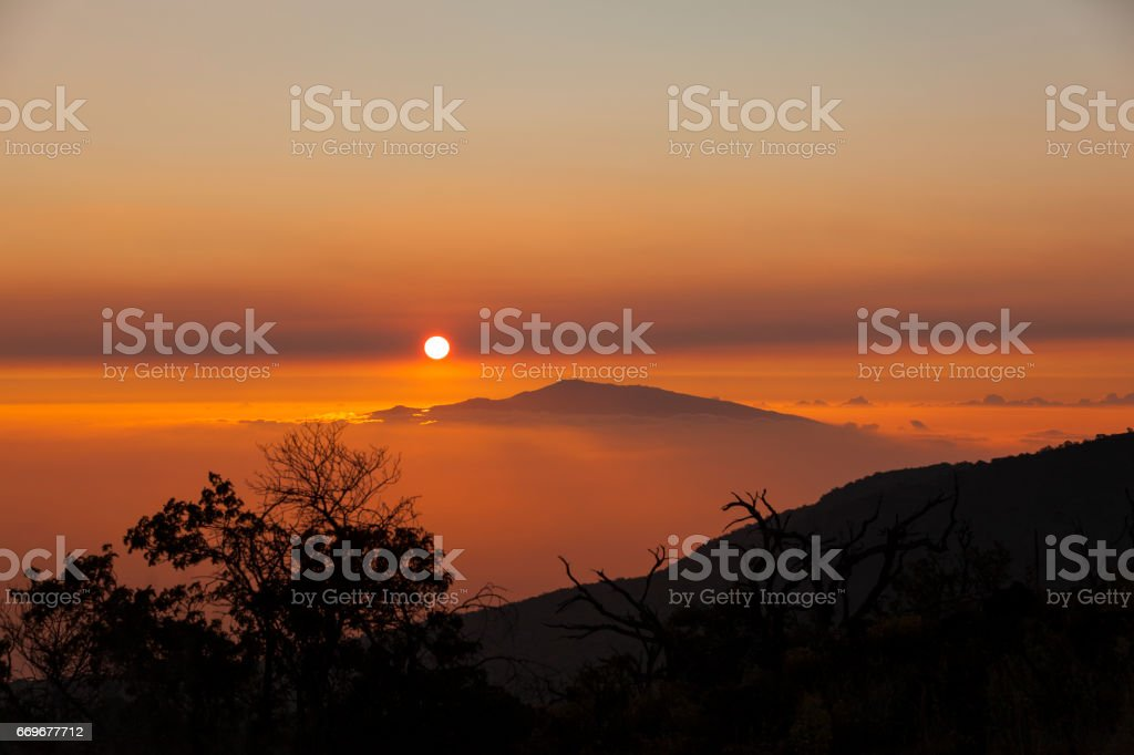 sunset view from mauna kea to haleakala stock photo